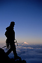 CC91138-90...WASHINGTON - Climber on Mount Rainier with Mount Adams in the distance. Mount Rainier National Park. (MR#K1)