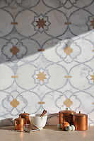 Vittoria, a handmade mosaic shown in honed Lagos Gold and polished Calacatta Tia and Allure is part of the Miraflores Collection by Paul Schatz for New Ravenna.<br />