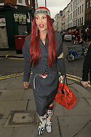 Pete Burns spotted in Soho, London, England.<br /> 17th February 2012<br /> full length grey gray pinstripe jacket skirt white boots red heart belt buckle bandana headband chaos bag purse <br /> CAP/IA<br /> &copy;Ian Allis/Capital Pictures /MediaPunch ***NORTH AND SOUTH AMERICAS ONLY*** /MediaPunch ***NORTH AND SOUTH AMERICAS ONLY***