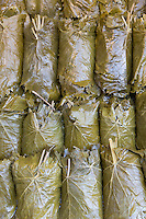 Stuffed vine leaves on display for sale at food market in Kadikoy district Asian side of Istanbul, East Turkey