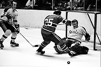 Seals vs Montreal Canadiens 1970...Seal goalie Gary Smith block shot by Jacques Lemaire, #3Harry Howell. (1970 photoby Ron Riesterer)