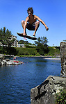 August 17, 2004 -- David Walsh, 17, shows off his skateboard technique as he glides out over the Clackamas River. High Rocks still attracts a lot of folks but has had a crew from AMR on hand during the summer months which has cut down on incidents.....KEYWORDS:  diving, danger