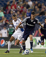 New England Revolution forward Milton Caraglio (9) controls the ball and moves forward as San Jose Earthquakes defender Jason Hernandez (21) defends. In a Major League Soccer (MLS) match, the San Jose Earthquakes defeated the New England Revolution, 2-1, at Gillette Stadium on October 8, 2011.