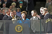 Chief Justice William H. Rehnquist administers the Oath of Office to George W. Bush to swear him in as the 43rd President of the United States at the U.S. Capitol in Washington, D.C. on January 20, 2001. Looking on from left are former U.S. President George H.W. Bush, Jenns Bush, Barbara Bush, and former U.S. President Bill Clinton..Credit: David N. Berkowitz for Newsweek - Pool via CNP.