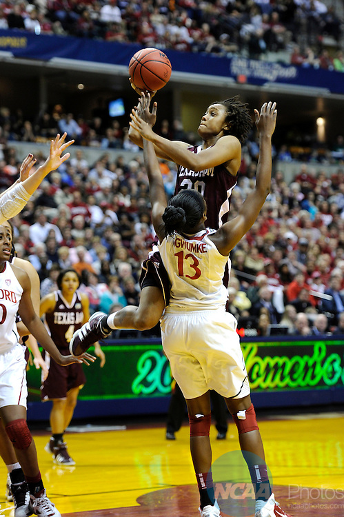 03 APR 2011:  Tyra White (20) of Texas A&M drives to the goal against Chiney Ogwumike (13) of Stanford University at the Division I Women's Basketball Semifinals held at Conseco Fieldhouse in Indianapolis, IN.  Texas A&M defeated Stanford by a score of 63-62 to advance to the National Championship game.  Stephen Nowland/NCAA Photos