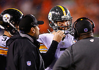 Ben Roethlisberger #7 of the Pittsburgh Steelers talks with Landry Jones #3, offensive coordinator Todd Haley, and head coach Mike Tomlin before taking the field for their final drive against the Cincinnati Bengals in the fourth quarter during the Wild Card playoff game at Paul Brown Stadium on January 9, 2016 in Cincinnati, Ohio. (Photo by Jared Wickerham/DKPittsburghSports)