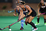 18 September 2015: Louisville's Stephanie Byrne (28) and North Carolina's Julia Young (behind). The University of North Carolina Tar Heels hosted the University of Louisville Cardinals at Francis E. Henry Stadium in Chapel Hill, North Carolina in a 2015 NCAA Division I Field Hockey match. UNC won the game 5-0.