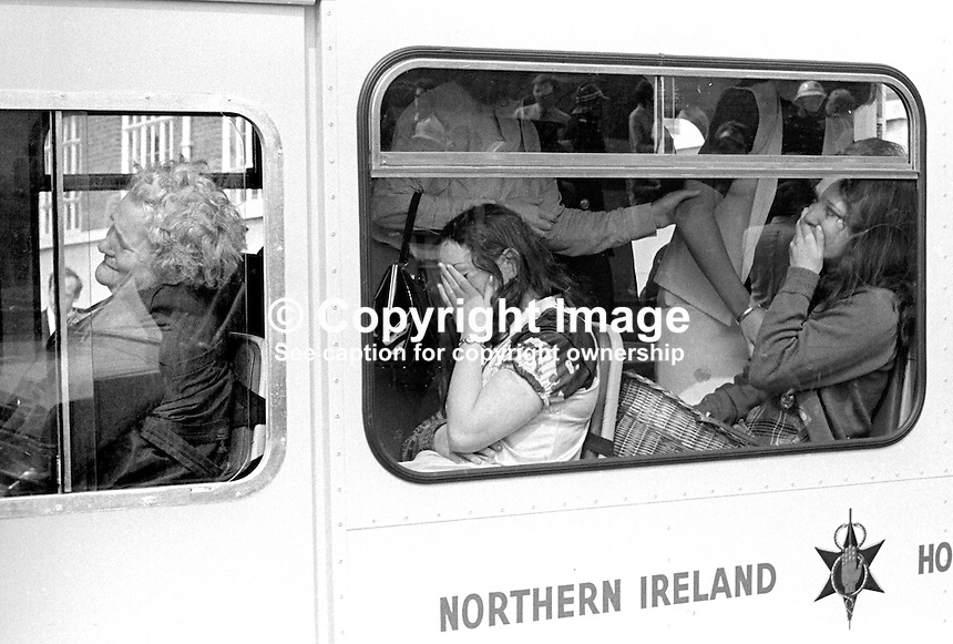 Distraught office workers in an ambulance following the explosion of a Provisional IRA bomb at the Belfast headquarters of the N Ireland Electricity Board. One man died in the blast and 35 others were injured. 25th August 1971. 197108250377b.Copyright Image from Victor Patterson, 54 Dorchester Park, Belfast, United Kingdom, UK...For my Terms and Conditions of Use go to http://www.victorpatterson.com/Victor_Patterson/Terms_%26_Conditions.html
