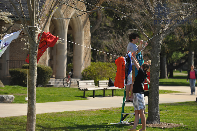 "Gender Relations Center students set up the ""Clothesline Project"", part of the Festival on the Quad...Photo by Matt Cashore/University of Notre Dame"