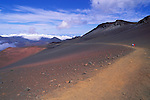 Hikers descending into Haleakala Crater on the Sliding Sands Trail, Haleakala National Park, Island of Maui, Hawaii