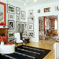 The large living room of the New York town house is filled with an eclectic collection of furniture and artworks