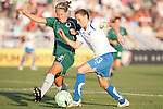 01 Aug 2009: Elise Weber (12) of Saint Louis Athletica tries to stop the forward movement of Kristine Lilly (13) of the Breakers.  Saint Louis Athletica defeated the visiting Boston Breakers 1-0 in a regular season Women's Professional Soccer game at Anheuser-Busch Soccer Park, in Fenton, MO.