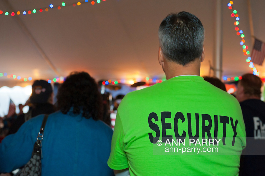"Fund raiser for firefighter Ray Pfeifer on Saturday, March 31, 2012, at East Meadow Firefighters Benevolent Hall, New York, USA. Throughout the tents filled with people and raffle prizes were those wearing green T-shirts labelled ""Security""."