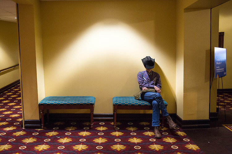 Durham, North Carolina - Friday May 20, 2016 -Lorin Edwin Parker, of Kentucky, relaxes in a hallway of the Carolina Theatre during Grouper's show Friday night during Moogfest.