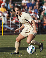 Boston College forward Stephanie McCaffrey (9) on the attack. .After two overtime periods, Boston College (gold) tied University of Miami (orange), 0-0, at Newton Campus Field, October 21, 2012.