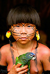 Yanomamo girl with blue-headed parrot, Parima Tapirapeco National Park, Venezuela