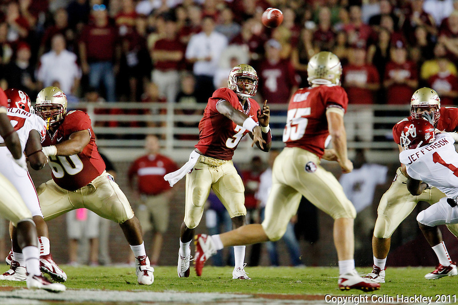 TALLAHASSEE, FL 9/17/11-FSU-OU091711 CH-Florida State quarterback EJ Manuel throws a pass to Nick O'Leary Oklahoma's during first half action Saturday at Doak Campbell Stadium in Tallahassee. .COLIN HACKLEY PHOTO