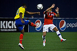 Ecuador's player Fricson Erazo ( L) fights for the ball against Chile's player Alexis Sanchez during their friendly match at the Citi-Field Stadium in New York, August 15, 2012. Photo by Eduardo Munoz Alvarez / VIEW.