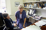 Professor Stephen Hawking Cambridge University in his office with his secretary Judy Fella. Cambridge UK. 31 July 1981.She is sitting on his knee for a student photograph.