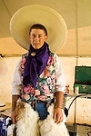 Ray Bard wears a big hat, wooly chaps and a wild blue rag a the Jordan Valley Big Loop Rodeo