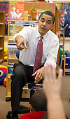 Chicago, Il - December 16, 2008 -- United States President-elect Barack Obama calls on a student as he and newly nominated Secretary of Education former Chicago School Chief Arne Duncan and Vice President-elect Joseph Biden speak to schoolchildren at Dodge Renaissance Academy on Chicago's West Side on Tuesday, December 16, 2008..Credit: Ralf-Finn Hestoft - Pool via CNP
