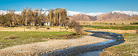 High country with farmland, old farming shed and Hills Creek near Ranfurly, Central Otago, New Zealand, NZ