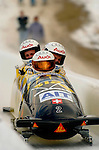 20 November 2005: Martin Annen, pilot of the Switzerland 1 sled, crosses the finish line for a 4th place finish at the 2005 FIBT AIT World Cup Men's 4-Man Bobsleigh Tour at the Verizon Sports Complex, in Lake Placid, NY. Mandatory Photo Credit: Ed Wolfstein.