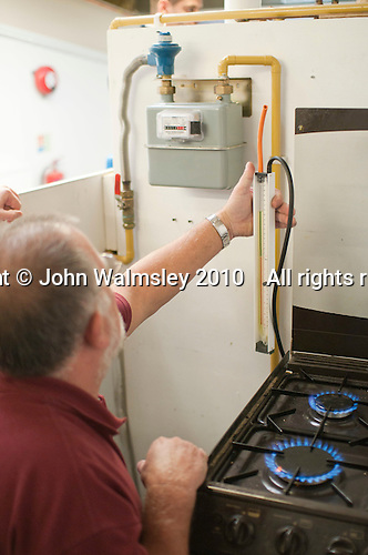 Student gas fitter testing gas pressure, Able Skills, Dartford, Kent.