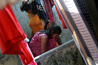 INDIA (West Bengal - Calcutta) - Sex workers taking bath in an open area. Munsiganj area Kolkata, India- Arindam Mukherjee