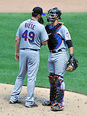 New York Mets pitcher Johnathan Niese (49) and catcher Josh Thole (30) discuss strategy on the mound in the fifth inning against the Washington Nationals at Nationals Park in Washington, D.C. on Sunday, July 31, 2011.  .Credit: Ron Sachs / CNP.(RESTRICTION: NO New York or New Jersey Newspapers or newspapers within a 75 mile radius of New York City)