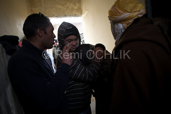 © Remi OCHLIK/IP3 -  Kasserine Tunisia - Saturday 24 January - Members of Mohammed Gedraoui familly mourn their chlid, the 23 years old boy had been killed by a snipper january 10, 2011..The 6 january 2011 a desperate young man  unemployed from set himself on fier in front of the rail way station of Kasserine. Next days demonstrations and riots took place in the citie. Policemen and police snipers  killed 56 protesters.