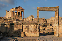 Low angle view of the Capitol, 2nd century, seen through the door frame of a house on the Roman market, in Dougga, Tunisia, pictured on January 31, 2008, in the afternoon. Dougga has been occupied since the 2nd Millennium BC, well before the Phoenicians arrived in Tunisia. It was ruled by Carthage from the 4th century BC, then by Numidians, who called it Thugga and finally taken over by the Romans in the 2nd century. Situated in the north of Tunisia, the site became a UNESCO World Heritage Site in 1997. This is one of the best preserved Roman temples in North Africa with a portico of six Corinthian columns. The market was initially a place for trading slaves. The door is left of one of the largest house of Dougga, called Dar el Acheb. Picture by Manuel Cohen.