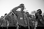 "8/30/2008 Ryak, Lebanon.Graduating Hezbollah Mahdi Scouts salute as dignitaries, including Nazil Fatih, General Secretary of the Mahdi Scouts, at ""Scout City"" in Lebanon's Beka'a valley...The Imam al-Mahdi Scouts are one of Hezbollah's many social programs in Lebanon. Originally founded in 1985, the youth-centered scout program includes both boys and girls, and counts at least 40,000 members in it's ranks, divided into the classifications of Cub, Scout, and Ranger. Although the Mahdi Scouts are part of the Lebanese Scouting Federation, and thereby The World Organization of the Scout Movement, it is believed by some intelligence services that the Mahdi Scouts serve as a recruiting tool for Hezbollah's armed wing, filtering out potential fighters based on their discipline and religious devotion, as well as initiating the male Scouts and Rangers into basic military training. In contrast to these accusations, much of the Mahdi Scouts visible activities center around intense religious education, outdoor activities, arts and crafts, performances, as well as community based social assistance and service similar to those practiced by scout movements around the world..."