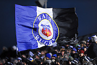 A fan in the crowd waves a giant Bath Rugby flag in support. Aviva Premiership match, between Bath Rugby and Northampton Saints on December 5, 2015 at the Recreation Ground in Bath, England. Photo by: Patrick Khachfe / Onside Images