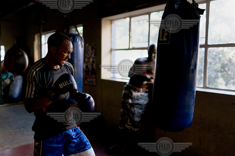 Siyakudumisa Vapi, a licensed boxer hoping to make it as a professional, trains at the Hillbrow Boxing Club in Johannesburg. Vapi is training for a fight against the third-ranked fighter in the national featherweight division. If he wins it wil bring him closer to his objective of challenging for the national title, and being able to make a decent living from boxing. He says boxing pulled him away from the streets and bad company, and gave him discipline.<br />  Hillbrow, in downtown Johannesburg, is the city's most notorious neighbourhood. It is overcrowded, ridden with illegal squats and suffers from high levels of crime much of which is related the thriving illicit drug trade. Against this backdrop, George Khosi's story is not atypical. A childhood spent on the streets, where he survived by committing petty crime and hustling, led to imprisonment at the age of 16. Because he was big and looked older than his age this incarceration was in an adult institution. Here he began to fight since, as he says 'they wanted to make me a woman and I didn't want to be a woman.' When he got out, he took up boxing in earnest.&nbsp;His prospects as a professional boxer looked bright until he was shot and left for dead during a burglary. He lost his right eye and now walks with a limp. His boxing career seemed over but George picked up his gloves again, this time to teach Hillbrow's youngsters. His gym became a place of hope and discipline for local youth, keeping them of the streets and even producing some national champions.