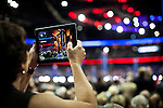 A delegate uses an iPad to photograph the Republican National Convention in downtown Tampa, Florida, August 29, 2012.