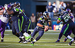 Seattle Seahawks quarterback Russell Wilson scrambles against the  Minnesota Vikings at CenturyLink Field in Seattle, Washington on  November 17, 2013. Wilson ran for 54 yards and passed for  two touchdowns in Seahawks 41-20 win over the Vikings.  ©2013.  Jim Bryant. All Rights Reserved.