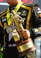 Sep 5, 2016; Clermont, IN, USA; Detailed view of the Wally trophy in the hand of NHRA top fuel driver Tony Schumacher as he celebrates after winning the US Nationals at Lucas Oil Raceway. Mandatory Credit: Mark J. Rebilas-USA TODAY Sports