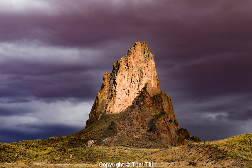 Agathla Peak and storm clouds,Monument Valley Tribal Park, Arizona, 1700 foot high diatreme