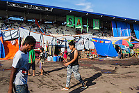 Survivors of the Zamboanga City rebel attack take refuge in the city's largest stadium in Zamboanga, Mindanao, The Philippines on November 4, 2013. These Internally Displaced People (IDP) had taken refuge in this Barangay (neighbourhood) after surviving the 3 week long attack by MNLF rebels. Photo by Suzanne Lee for SPRINT-IPPF