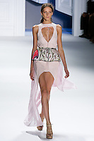 Iris Egbers walks runway in a rose pebble crepe high-low gown with plunging V-cutout and magenta psychedelic printed cotton belt.by Vera Wang, for the Vera Wang Spring 2012 collection, during Mercedes-Benz Fashion Week Spring 2012.