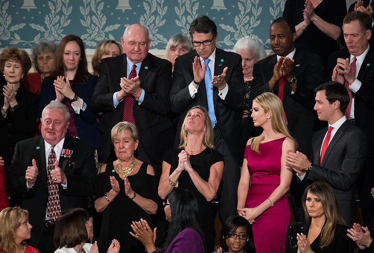 "UNITED STATES - FEBRUARY 28: Carryn Owens, widow of Navy SEAL William ""Ryan"" Owens, reacts after being recognized by President Donald Trump during his address to a joint session of Congress on Tuesday, February 28, 2017. Owens was killed in January during a raid in Yemen. (Photo By Bill Clark/CQ Roll Call)"