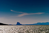 "View from Morgan Lake of Shiprock Pinnacle or Tse Bit a'i (""rock with wings"" in Navajo), a rock formation that rises approx. 1800 feet above the desert near the town of Shiprock on the Navajo Nation in New Mexico, USA."