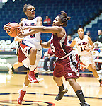 "Mississippi's Valencia McFarland (3) is fouled by UMass' Dee Montgomery (25) at the C.M. ""Tad"" Smith Coliseum in Oxford, Miss. on Saturday, December 8, 2012. (AP Photo/Oxford Eagle, Bruce Newman)"