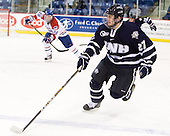 Kevin Goumas (UNH - 27) - The visiting University of New Hampshire Wildcats defeated the University of Massachusetts-Lowell River Hawks 3-0 on Thursday, December 2, 2010, at Tsongas Arena in Lowell, Massachusetts.