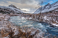 Winter landscape of South Fork of Campbell creek with frozen portions with Chugach Mountains in Chugach State Park. Glenn Alps area of Anchorage, Alaska   November 2016<br /> <br /> Photo by Jeff Schultz/SchultzPhoto.com  (C) 2016  ALL RIGHTS RESVERVED