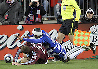 Atiba Harris#16 of FC Dallas crashes into Julien Baudet#21 of the Colorado Rapids during MLS Cup 2010 at BMO Stadium in Toronto, Ontario on November 21 2010.Colorado won 2-1 in overtime.