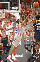 Ohio State Buckeyes forward LaQuinton Ross (10) cannot stop Michigan Wolverines guard Derrick Walton Jr. (10) from getting off a shot in the second half at Nationwide Arena on February 11,  2014. (Chris Russell/Dispatch Photo)