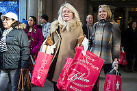Shoppers in Herald Square outside Macy's Herald Square flagship store in New York looking for bargains on Black Friday, the day after Thanksgiving, Friday, November 29, 2013. Many retailers, including Macy's, opened their doors on Thanksgiving or opened up for Black Friday the night before extending the shopping day into over 24 hours. (© Frances M. Roberts)