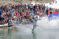 """Cushing Classic at Squaw Valley 3"" - Photograph of a skier crossing a pond during the Cushing Classic at Squaw Valley, USA."